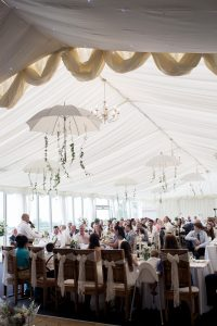 Hanging umbrellas from the marquee with ivy and greenery